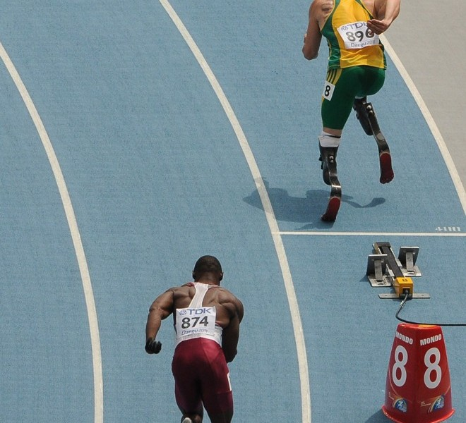 South Africa's Oscar Pistorius (R) and Qatar's Femi Ogunode (L) compete in the men's 400 metres heats at the International Association of Athletics Federations (IAAF) World Championships in Daegu on August 28, 2011. AFP PHOTO / ANTONIN THUILLIER