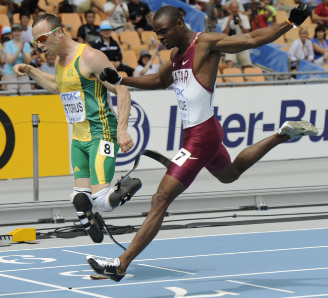South Africa's Oscar Pistorius (L) and Qatar's Femi Ogunode compete in the men's 400 metres heats at the International Association of Athletics Federations (IAAF) World Championships in Daegu on August 28, 2011.   AFP PHOTO / PETER PARKS