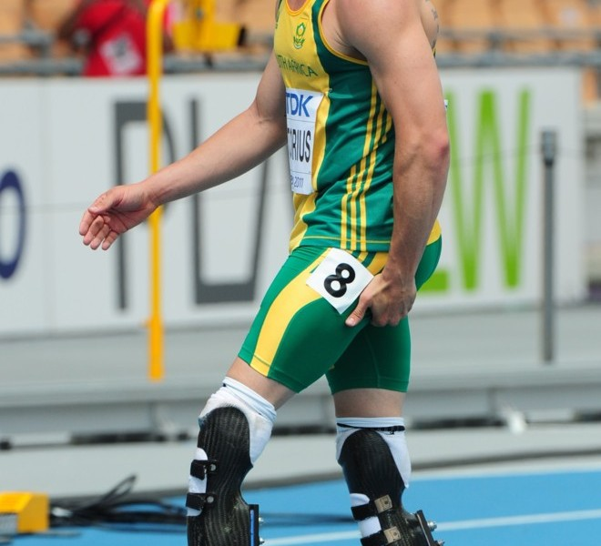 South Africa's Oscar Pistorius leaves the track holding the back of his leg at the end of his race in the men's 400 metres heats at the International Association of Athletics Federations (IAAF) World Championships in Daegu on August 28, 2011.  AFP PHOTO / MARK RALSTON