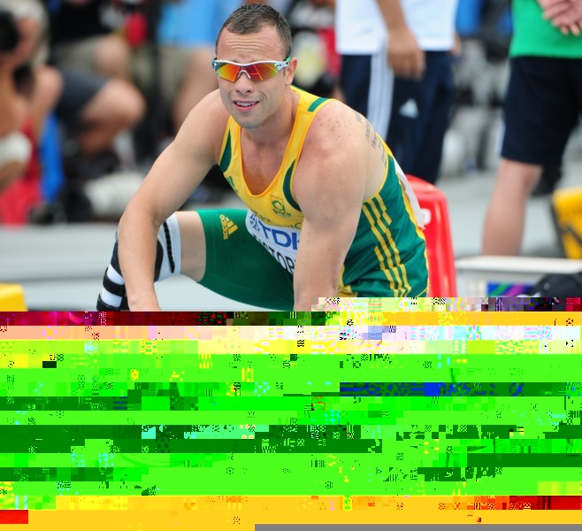 South Africa's Oscar Pistorius prepares to settle into the blocks to compete in the men's 400 metres heats at the International Association of Athletics Federations (IAAF) World Championships in Daegu on August 28, 2011.      AFP PHOTO / MARK RALSTON