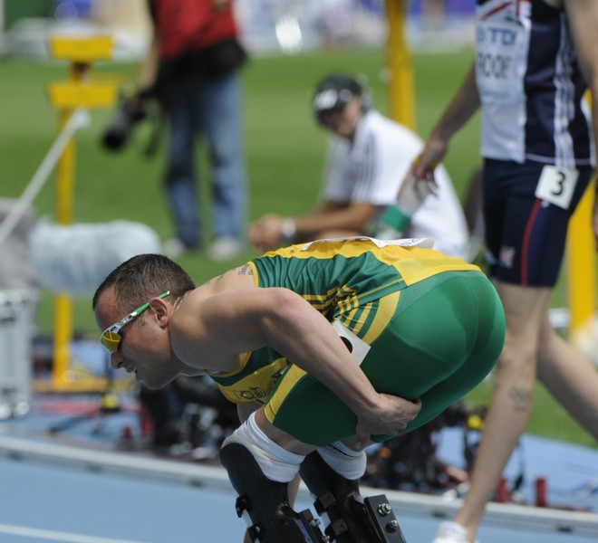 South Africa's Oscar Pistorius crouches on the track as he holds the back of his leg after finishing the men's 400 metres heats at the International Association of Athletics Federations (IAAF) World Championships in Daegu on August 28, 2011.     AFP PHOTO / OLIVIER MORIN