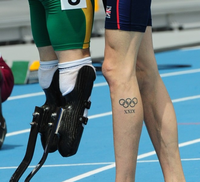 A picture shows the prosthetic running blades of South Africa's Oscar Pistorius (L) as he stands next to Britain's Martyn Rooney (R) at the end of their race in the men's 400 metres heats at the International Association of Athletics Federations (IAAF) World Championships in Daegu on August 28, 2011.  AFP PHOTO / MARK RALSTON