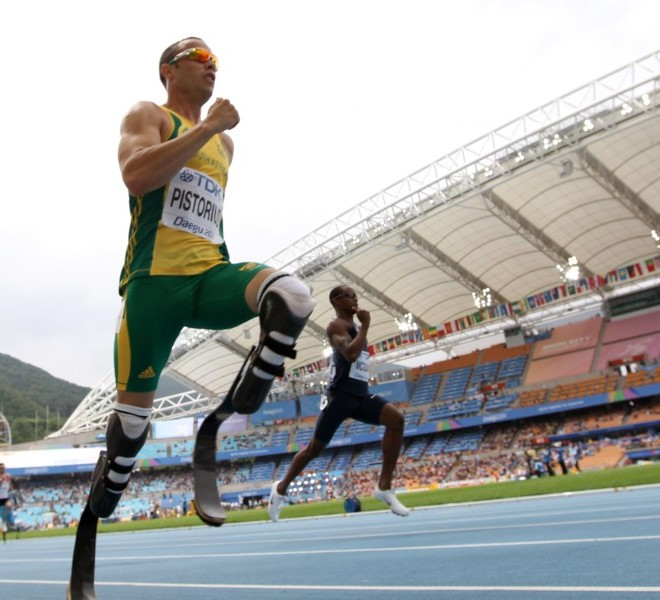 (L-R) South Africa's Oscar Pistorius and US athlete Tony McQuay compete in the men's 400 metres heats at the International Association of Athletics Federations (IAAF) World Championships in Daegu on August 28, 2011.    AFP PHOTO / ADRIAN DENNIS