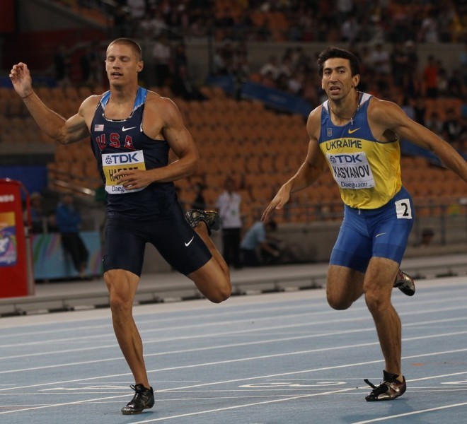 US athlete Trey Hardee (L) and Ukraine's Oleksiy Kasyanov compete in the men's 400 metres of the decathlon event at the International Association of Athletics Federations (IAAF) World Championships in Daegu on August 27, 2011.   AFP PHOTO / ADRIAN DENNIS