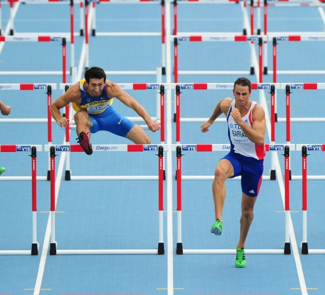 (L-R) South Africa's Willem Coertzen, Ukraine's Oleksiy Kasyanov, France's Romain Barras and Lithuania's Darius Draudvila compete in the 110 metres hurdles of the men's decathlon event at the International Association of Athletics Federations (IAAF) World Championships in Daegu on August 28, 2011. AFP PHOTO / MARK RALSTON