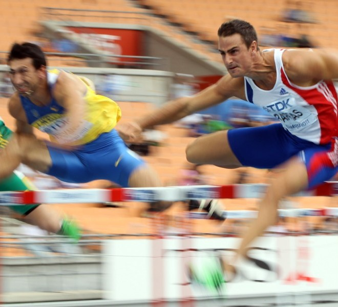(L-R) Ukraine's Oleksiy Kasyanov and France's Romain Barras compete in the 110 metres hurdles of the men's decathlon event at the International Association of Athletics Federations (IAAF) World Championships in Daegu on August 28, 2011.     AFP PHOTO / ADRIAN DENNIS