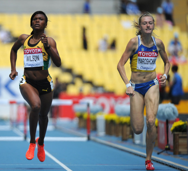 Jamaica's Nickiesha Wilson (L) and Ukraine's Hanna Yaroshchuk  compete in the women's 400 metres hurdles heats at the International Association of Athletics Federations (IAAF) World Championships in Daegu on August 29, 2011.  AFP PHOTO / OLIVIER MORIN