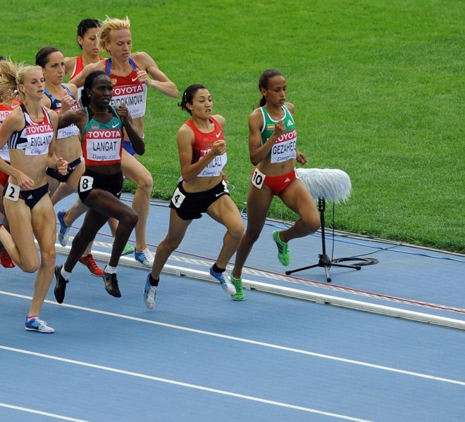 (L-R) Ukraine's Anzhelika Shevchenko, Britain's Hannah England, Kenya's Nancy Jebet Langat, Morocco's Siham Hilali and Ethiopia's Kalkidan Gezahegne lead the the pack during the women's 1,500 metres heats at the International Association of Athletics Federations (IAAF) World Championships in Daegu on August 28, 2011. AFP PHOTO / JUNG YEON-JE