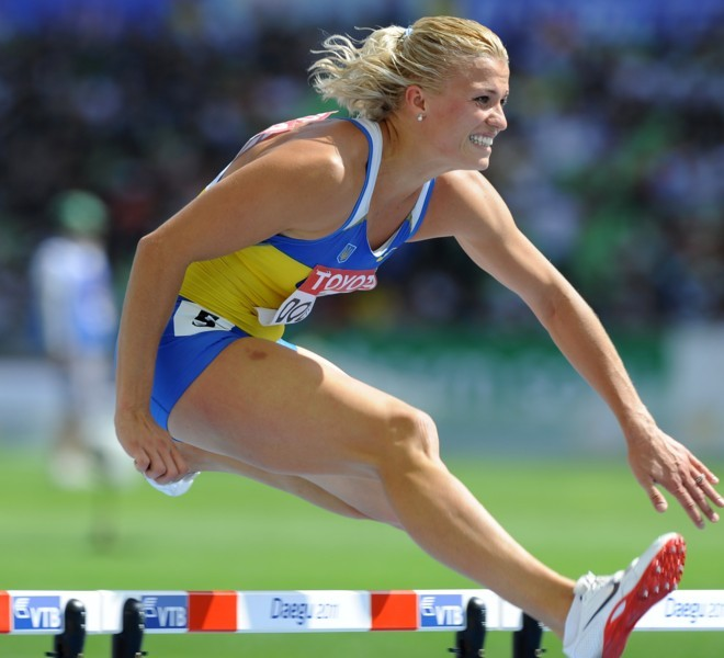 Ukraine's Natalia Dobrynska competes in the 100 metres hurdles of the women's heptathlon event at the International Association of Athletics Federations (IAAF) World Championships in Daegu on August 29, 2011.  AFP PHOTO / JUNG YEON-JE