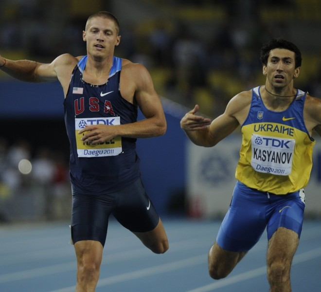 US athlete Trey Hardee (L) and Ukraine's Oleksiy Kasyanov compete in the men's 400 metres of the decathlon event at the International Association of Athletics Federations (IAAF) World Championships in Daegu on August 27, 2011.   AFP PHOTO / OLIVIER MORIN