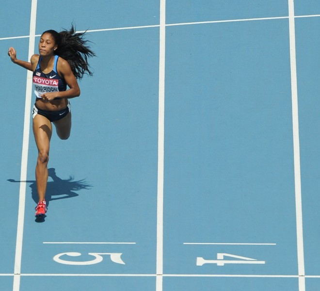 (From L) Ukraine's Anastasiya Rabchenyuk, US Queen Harrison and Jamaica's Kaliese Spencer run during the women's 400 metres hurdles heats at the International Association of Athletics Federations (IAAF) World Championships in Daegu on August 29, 2011.  AFP PHOTO / ANTONIN THUILLIER