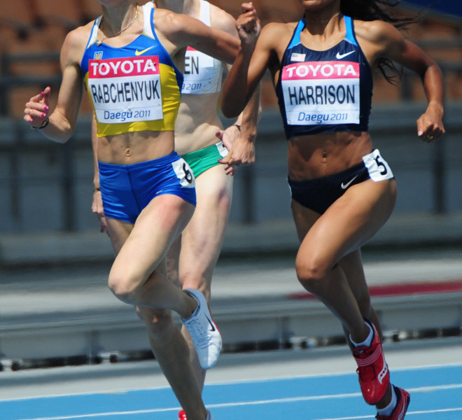 (L-R) Ukraine's Anastasiya Rabchenyuk and US athlete Queen Harrison compete in the women's 400 metres hurdles heats at the International Association of Athletics Federations (IAAF) World Championships in Daegu on August 29, 2011. AFP PHOTO / MARK RALSTON