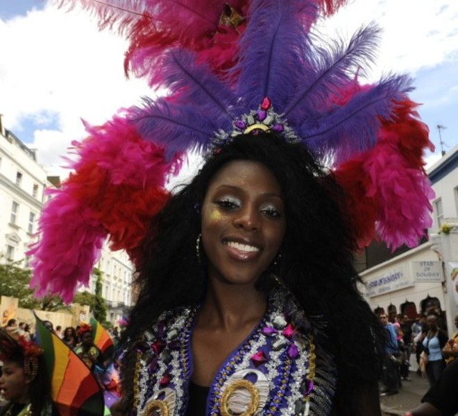 A performer takes part in the Notting Hill Carnival children's day in London, on August 28, 2011. London's police were out in force as the Notting Hill Carnival got under way today in a bid to stop Europe's biggest street festival descending into a repeat of this month's devastating riots. The two-day showcase of Caribbean culture in west London attracts up to a million revellers to watch troupes of dancers in exotic costumes perform on floats as powerful sound systems pump out music. AFP PHOTO/ FACUNDO ARRIZABALAGA