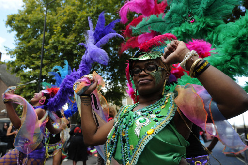 Performers take part in the Notting Hill Carnival children's day in London, on August 28, 2011. London's police were out in force as the Notting Hill Carnival got under way today in a bid to stop Europe's biggest street festival descending into a repeat of this month's devastating riots.     AFP PHOTO/ CARL COURT