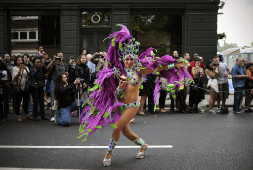 A performer takes part in the Notting Hill Carnival in London, on August 29, 2011. Monday, a public holiday, is the second and busiest day of the two-day festival which attracts around one million people, and there are fears gangs could hijack the event and go on the rampage in a repeat of the riots. AFP PHOTO / CARL COURT