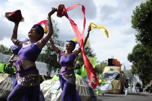 Performers take part in the Notting Hill Carnival in London, on August 29, 2011. Monday, a public holiday, is the second and busiest day of the two-day festival which attracts around one million people, and there are fears gangs could hijack the event and go on the rampage in a repeat of the riots. AFP PHOTO / CARL COURT