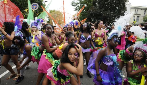 Performers dance during the  Notting Hill Carnival last day in London,  on August 29, 2011. London's police were out in force as the Notting Hill Carnival got under way Sunday in a bid to stop Europe's biggest street festival descending into a repeat of this month's devastating riots. The two-day showcase of Caribbean culture in west London attracts up to a million revellers to watch troupes of dancers in exotic costumes perform on floats as powerful sound systems pump out music. AFP PHOTO/FACUNDO ARRIZABALAGA