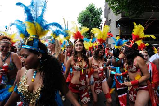 Performers dance at the finale of the Notting Hill Carnival in London on August 29, 2011. Today is the second and busiest day of the two-day festival which attracts around a million people, and there were fears gangs could hijack the event and go on the rampage in a repeat of this month's riots. But the second day of festivities started peacefully with 6,500 police officers, the biggest number in recent years at the Caribbean-themed extravaganza, on duty as spectators watched Samba-style dancers perform on floats.   AFP PHOTO / FACUNDO ARRIZABALAGA