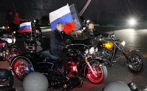 "Russian Prime Minister Vladimir Putin (L) and the leader of the Night Wolves biker group, Alexander Zaldostanov (R), also known as the Surgeon, ride motorcycles on August 29, 2011 at a bikers' festival in the Black Sea port of Novorossiysk, Russia. Putin described leather-clad bikers as brothers and boasted of the ""indivisible Russian nation"" after roaring into a biking rally on a Harley Davidson. AFP PHOTO / IVAN SEKRETAREV"