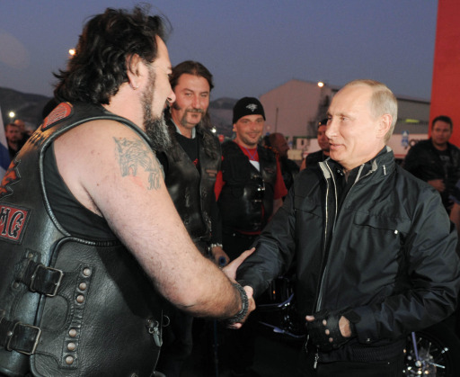 "Russian Prime Minister Vladimir Putin (R) speaks with a biker as he takes part in the 16th annual motorbike festival held by ""The Night Wolves"" youth organization in the southern Russian town of Novorossiysk, on August 29, 2011. AFP PHOTO / RIA NOVOSTI / POOL / ALEXEY DRUZHININ"