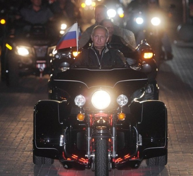 "Russian Prime Minister Vladimir Putin rides a motorbike as he takes part in the 16th annual motorbike festival held by ""The Night Wolves"" youth organization in the southern Russian town of Novorossiysk, on August 29, 2011. AFP PHOTO / RIA NOVOSTI / POOL / ALEXEY DRUZHININ"