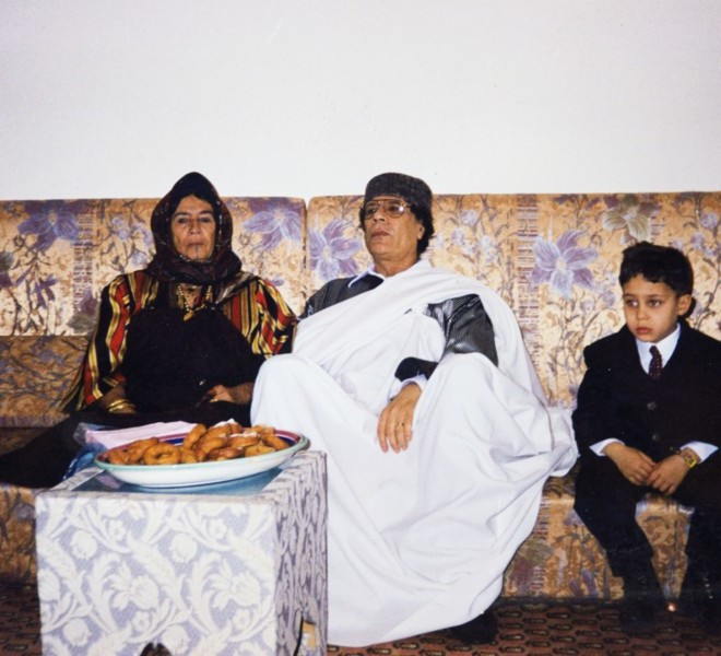 An undated photo shows Libya's embattled leader Moamer Kadhafi during a family visit, found in a family album at his wrecked former headquarters in Tripoli's Bab al-Aziziya compound on August 28, 2011. AFP PHOTO