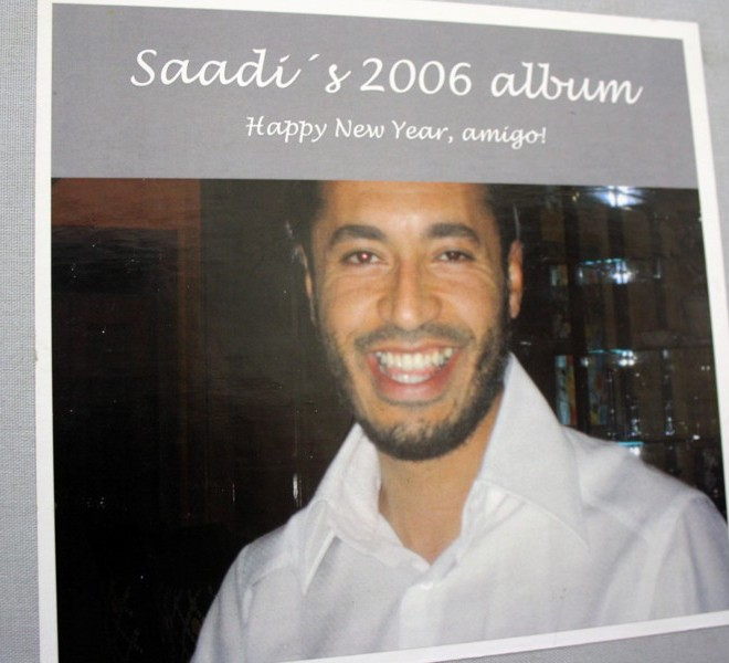 A reproduction of a photo of Moamer Kadhafi's son Saadi, from an album dated 2006 and sent to him as a new year's gift by a New York-based friend called Linda, is taken on August 29, 2011 after it was found at his abandoned rest house in Tripoli. AFP PHOTO/PATRICK BAZ