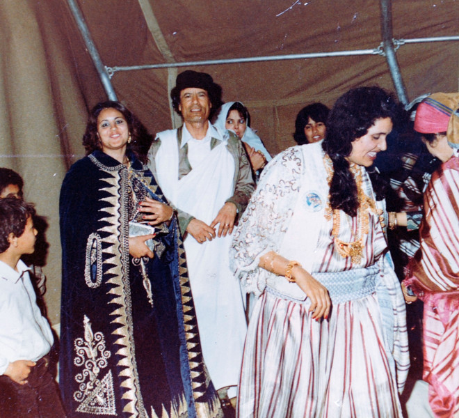 An undated photo shows Libya's embattled leader Moamer Kadhafi (C) and his wife Safiya (2nd R) during a wedding party, found in a family album at his wrecked former headquarters in Tripoli's Bab al-Aziziya compound on August 28, 2011.  AFP PHOTO