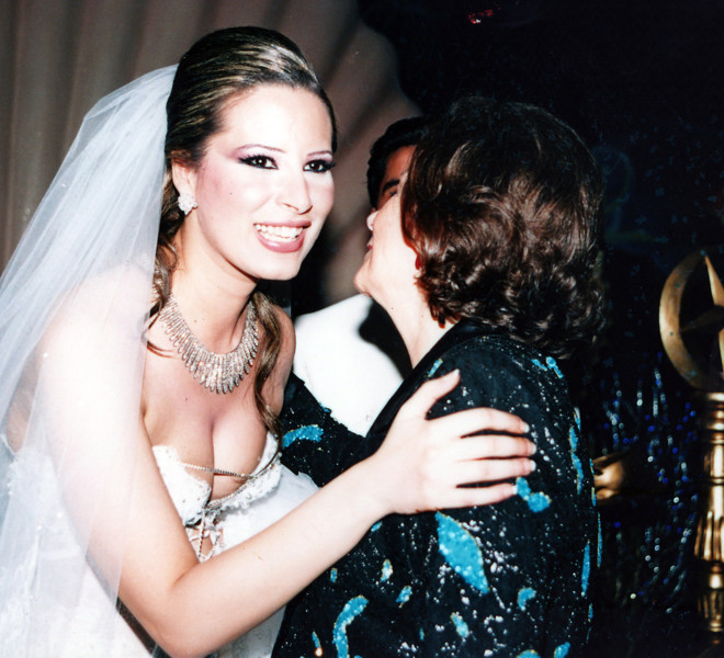 "A reproduction of an undated file photo found in a family album at Moamer Kadhaf's former headquarters in Tripoli's Bab al-Aziziya compound on August 28, 2011 shows Kadhafi's daughter Aisha (L) hugging an unidentified guest on her wedding day. Aisha Kadhafi gave birth to a baby girl in Algeria on August 30, 2011 as Algiers said it decided to grant safe haven to the wife and three children of the ousted Libyan leader for ""strictly humanitarian reasons."" AFP PHOTO/HO"
