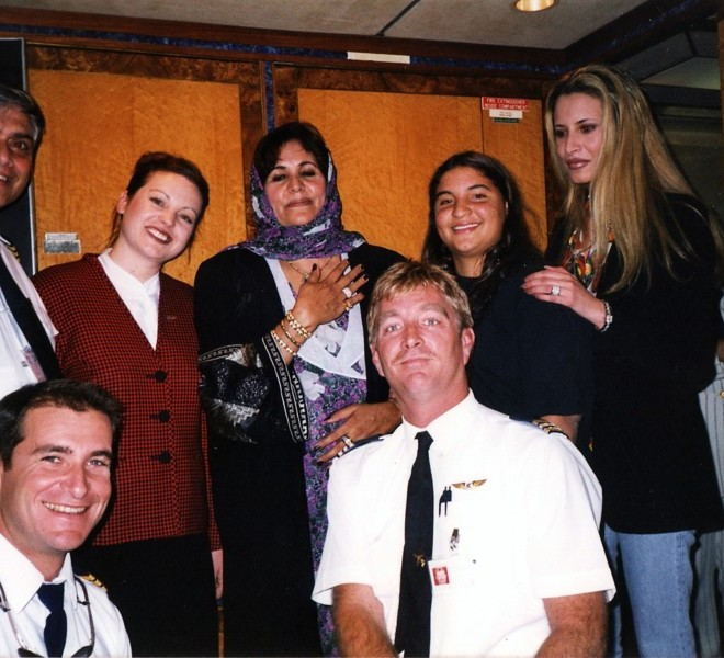 "A reproduction of an undated file photo found in a family album at Moamer Kadhafi's former headquarters in Tripoli's Bab al-Aziziya compound on August 28, 2011 shows Kadhafi's daughter Aisha (R) and her mother Safiya (C) with an unidentified plane crew. Aisha Kadhafi gave birth to a baby girl in Algeria on August 30, 2011 as Algiers said it decided to grant safe haven to the wife and three children of the ousted Libyan leader for ""strictly humanitarian reasons."" AFP PHOTO/HO"