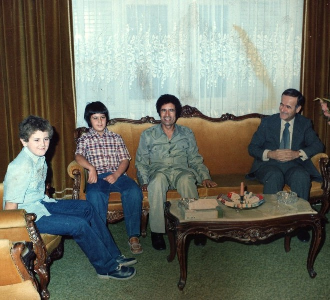 A reproduction of an undated file photo found in a family album at Moamer Kadhafi's former headquarters in Tripoli's Bab al-Aziziya compound on August 30, 2011 shows Kadhafi (C) meeting with then Syrian president Hafez al-Assad and his sons Bassel (2nd-L) and Maher (L) in Damascus. AFP PHOTO/HO