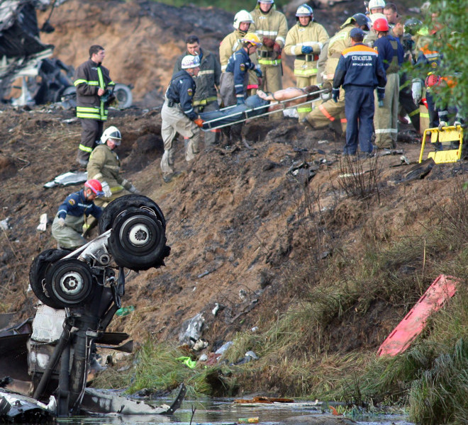 YAROSLAVL REGION, RUSSIA. SEPTEMBER 7. 2011. Rescuers work at the crash site of a Yak-42 passenger plane in the Yaroslavl Region. The jet carrying a KHL ice hockey team Lokomotiv crashed here on September 7 killing 36 people. (Photo ITAR-TASS / Vladimir Smirnov)