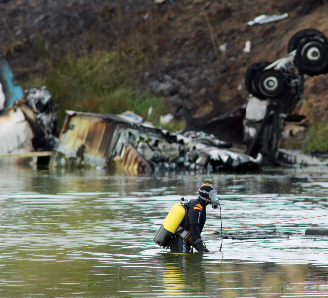 YAROSLAVL REGION, RUSSIA. SEPTEMBER 7. 2011. A search and rescue operation being carried out in the Yaroslavl Region, where a Yak-42 passenger plane with a KHL ice hockey team Lokomotiv on board crashed on September 7 killing 36 people. (Photo ITAR-TASS / Vladimir Smirnov)