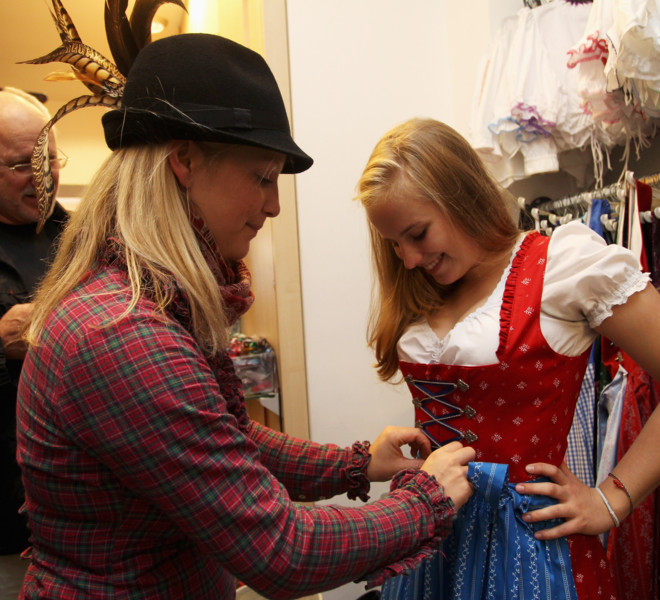 MUNICH, GERMANY - SEPTEMBER 08:  A customer is provided with a traditional Bavarian Dirndl dress at a shop selling Dirndl dresses and leather trousers on September 8, 2011 in Munich, Germany. Dirndl dresses are famous to be worn during the world's biggest beer festival Oktoberfest which will last from September 7 to October 3, 2011 in Munich.  (Photo by Alexandra Beier/Getty Images)