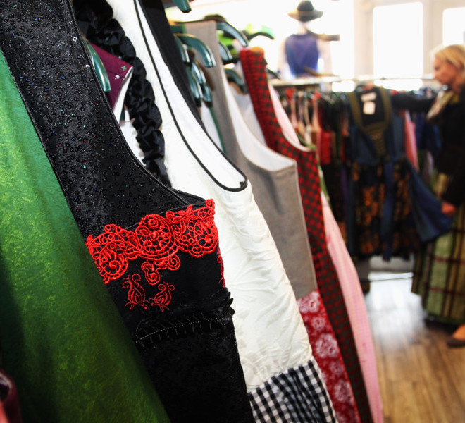 MUNICH, GERMANY - SEPTEMBER 08:  A saleswoman loks at a traditional Bavarian Dirndl dress at a shop on September 8, 2011 in Munich, Germany. Dirndl dresses are famous to be worn during the world's biggest beer festival Oktoberfest which will last from September 7 to October 3, 2011 in Munich.  (Photo by Alexandra Beier/Getty Images)