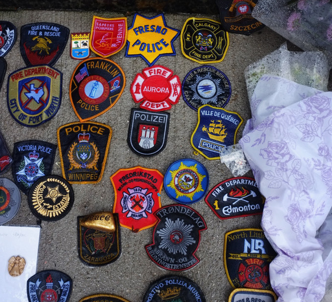 NEW YORK, NY - SEPTEMBER Police and fire patches from around the world are placed in front of a memorial next to the World Trade Center site on September 6, 2011 in New York City. New York City and the nation are preparing for the 10th anniversary of the terrorist attacks on lower Manhattan which resulted in the deaths of 2,753 people in the attacks on the World Trade Center.  (Photo by Spencer Platt/Getty Images)
