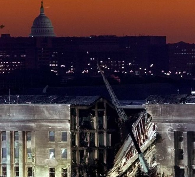 (FILES) This September 13, 2001 file photo shows the sky glowing orange as the sun rises over the damaged side of the Pentagon with the US Capitol behind in Washington, DC. September 11, 2011 will mark the tenth anniversary of the attacks in which nearly 3,000 people were killed, 2,753 at the World Trade Center and the others in attacks on the Pentagon and in a hijacked plane that crashed in Pennsylvania.  AFP PHOTO/  Luke FRAZZA / FILES