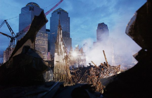 (FILES) This September 25, 2001 file photo shows early morning light illuminating the wreckage of the World Trade Center in New York. September 11, 2011 will mark the tenth anniversary of the attacks in which nearly 3,000 people were killed, 2,753 at the World Trade Center and the others in attacks on the Pentagon and in a hijacked plane that crashed in Pennsylvania.     AFP PHOTO/Eric FEFERBERG