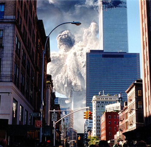 (FILES) This September 11, 2001 file photo shows the south tower of the World Trade Center collapsing, sending dust and smoke into the streets in New York. September 11, 2011 will mark the tenth anniversary of the attacks in which nearly 3,000 people were killed, 2,753 at the World Trade Center and the others in attacks on the Pentagon and in a hijacked plane that crashed in Pennsylvania.   AFP PHOTO/Aaron MILESTONE / FILES
