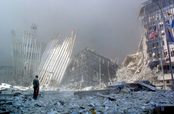(FILES) This September 11, 2001 file photo shows a man standing in the rubble, and calling out asking if anyone needs help, after the collapse of the first World Trade Center Tower in New York. September 11, 2011 will mark the tenth anniversary of the attacks in which nearly 3,000 people were killed, 2,753 at the World Trade Center and the others in attacks on the Pentagon and in a hijacked plane that crashed in Pennsylvania. AFP PHOTO / Doug KANTER / FILES