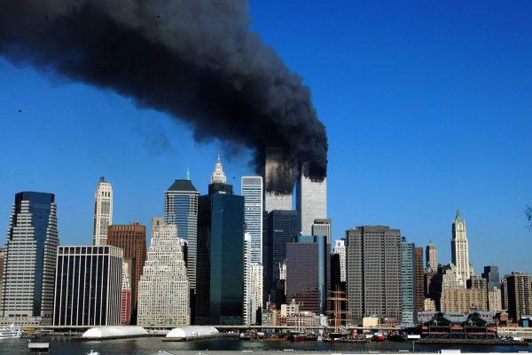 (FILES) This September 11, 2001 file photo shows the twin towers of the World Trade Center billowing smoke after commercial airliners were crashed into the buildings in New York. September 11, 2011 will mark the tenth anniversary of the attacks in which nearly 3,000 people were killed, 2,753 at the World Trade Center and the others in attacks on the Pentagon and in a hijacked plane that crashed in Pennsylvania.  AFP PHOTO/Henny Ray ABRAMS
