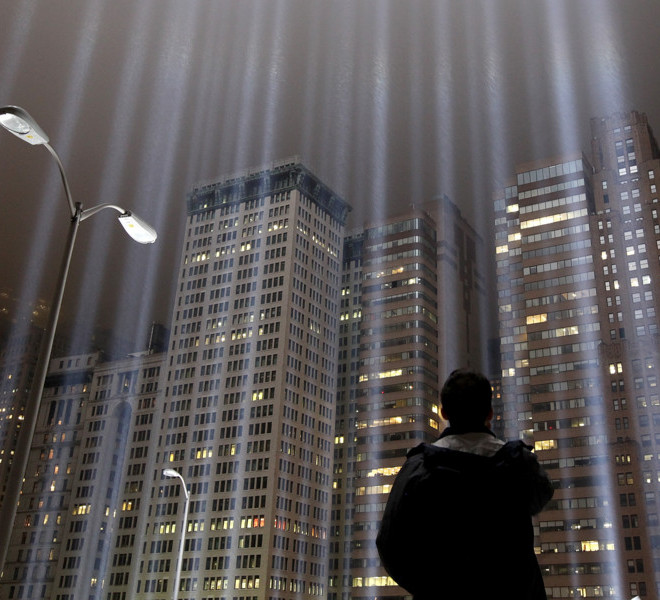 NEW YORK, NY - SEPTEMBER 07:  A worker looks up at beams of the Tribute in Lights ahead of the tenth anniversary of the September 11 terrorist attacks on September 7, 2011 in New York City. The Tribute in Light is comprised of 88 7000 watt searchlights that beam into the sky near the site of the World Trade Center in remembrance of the September 11 attacks.  (Photo by Justin Sullivan/Getty Images)
