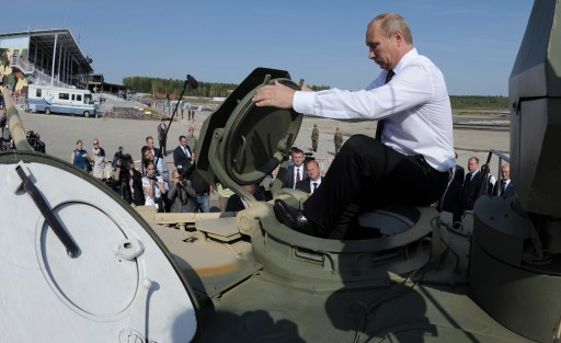 Russia's Prime Minister Vladimir Putin gets into a T-90AM tank during a visit to an arms exhibition in the Urals town of Nizhny Tagil, on September 9, 2011.  AFP PHOTO/ RIA-NOVOSTI POOL/ ALEXEY DRUZHININ