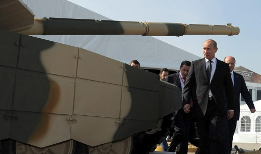 Russia's Prime Minister Vladimir Putin passes by a T-90AM tank during his visit to an arms exhibition in the Urals town of Nizhny Tagil, on September 9, 2011.  AFP PHOTO/ RIA-NOVOSTI POOL/ ALEXEY DRUZHININ