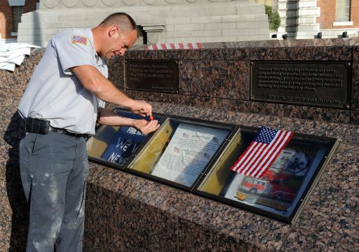 LAS VEGAS, NV - SEPTEMBER 11: New York-New York Hotel & Casino engineer Dan Loyd cleans the glass at the Tribute to Heroes of 9/11 display outside the resort September 11, 2011 in Las Vegas, Nevada. Las Vegas is joining the rest of the nation in commemorating the tenth anniversary of the September 11, 2001 terrorist attacks.   Ethan Miller/Getty Images/AFP== FOR NEWSPAPERS, INTERNET, TELCOS & TELEVISION USE ONLY ==