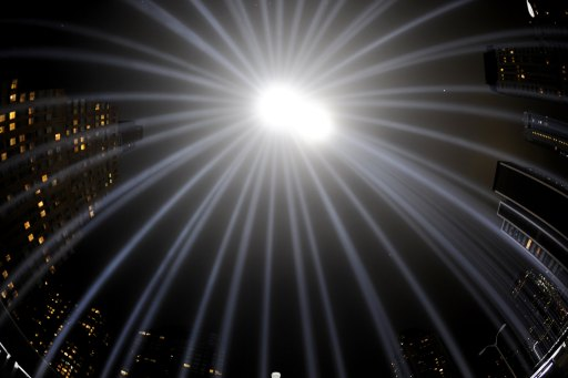 The ?Tribute in Light? illuminates the sky on the 9/11 10th Anniversary in New York on September 11, 2011. The Tribute in Light, an art installation of the Municipal Art Society, consists of 88 searchlights placed next to the site of the World Trade Center to create two vertical columns of light in remembrance of the September 11 attacks.  AFP PHOTO / TIMOTHY A.CLARY