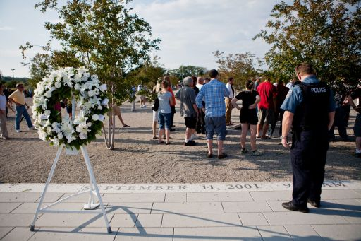 ARLINGTON, VA - SEPTEMBER 11: A wreath of flowers placed earlier by President Barack Obama marks the entrance to the Pentagon Memorial on September 11, 2011 in Arlington, Virginia. The memorial commemorates the 184 victims of the September 11 terrorist attacks both at the Pentagon and on American Airlines Flight 77.   Brendan Hoffman/Getty Images/AFP== FOR NEWSPAPERS, INTERNET, TELCOS & TELEVISION USE ONLY ==