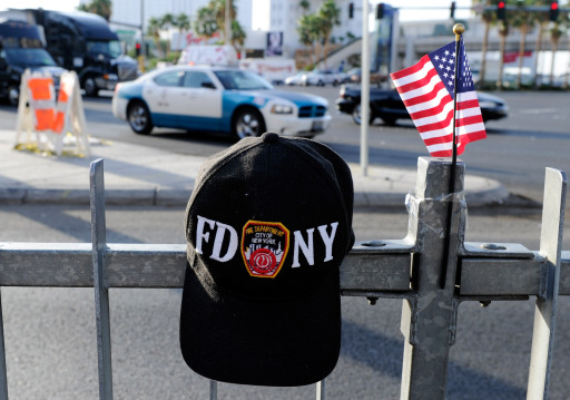 LAS VEGAS, NV - SEPTEMBER 11: A New York Fire Department hat and an American flag sit on a fence at the Tribute to Heroes of 9/11 display outside the New York-New York Hotel & Casino on September 11, 2011 in Las Vegas, Nevada. Las Vegas is joining the rest of the nation in commemorating the tenth anniversary of the September 11, 2001 terrorist attacks.   Ethan Miller/Getty Images/AFP== FOR NEWSPAPERS, INTERNET, TELCOS & TELEVISION USE ONLY ==