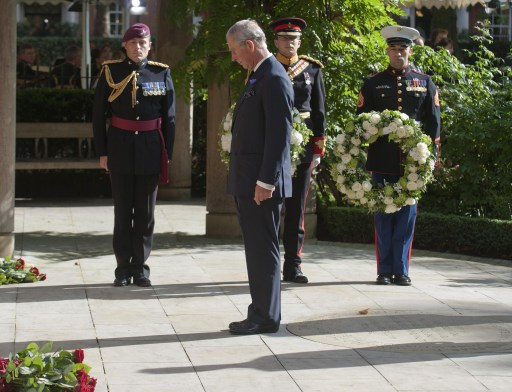 Britain's Prince Charles lays a wreath in the Sept 11 memorial gardens in Grovesnor Square during a memorial ceremony for victims of the attacks on the World Trade Centre in New York marking the tenth anniversary in London on September 11, 2011. Prince Charles and Prime Minister David Cameron joined relatives of the 67 British victims of the September 11 attacks at a service in London today marking 10 years since the atrocity.   AFP PHOTO/ WPA POOL/ DAVID PARKER