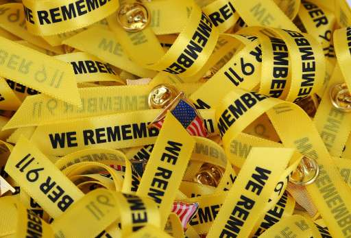 TOPSHOTS Ribbons remembering the victims of the September 11, 2001 attacks are offered to attendees at ceremonies in at the Fire Department's Frank Hotchkin Memorial Training Center in Los Angeles, California September 11, 2011.  TOPSHOTS/AFP PHOTO / ROBYN BECK